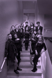 student cast on stairs
